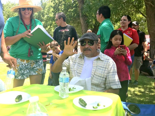 Daniel Archuleta won the jalapeno eating contest for the third year in a row at the third annual Luna County Salsa Festival.