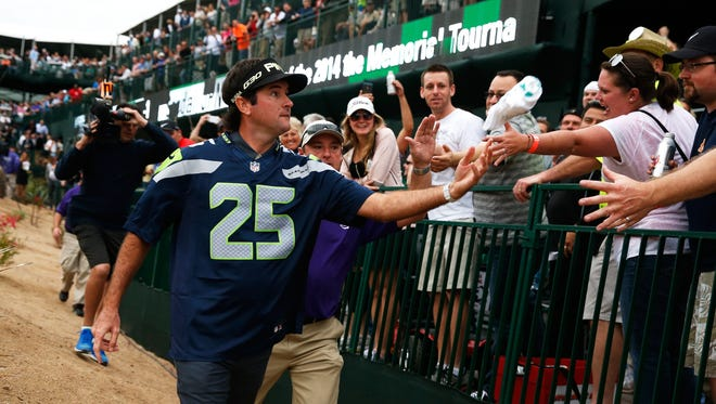 Bubba Watson sports a Richard Sherman jersey on the 16th hole at the TPC Scottsdale during the first round of the 2015 Waste Management Phoenix Open.