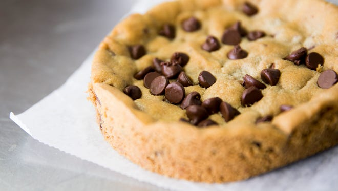 Serious Cookie Company's signature item, a plate-sized chocolate chip cookie.