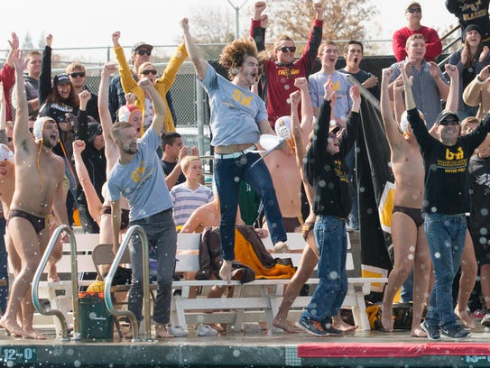 Golden West fans, coaches and players celebrate a 7-5