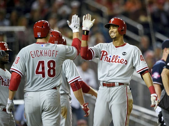 Philadelphia Phillies' Aaron Altherr, right, celebrates his inside-the-park grand slam with Jerad Eickhoff (48) during the third inning of Friday's game against the Washington Nationals. The Phillies won, 8-2.