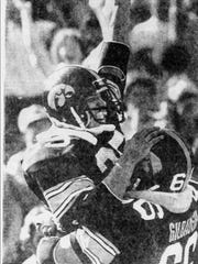After a 27-yard run, Dean McKillip and Greg Gilbaugh savor the Hawkeyes' final touchdown in their 30-14 win in the 1979 Cy-Hawk football game.