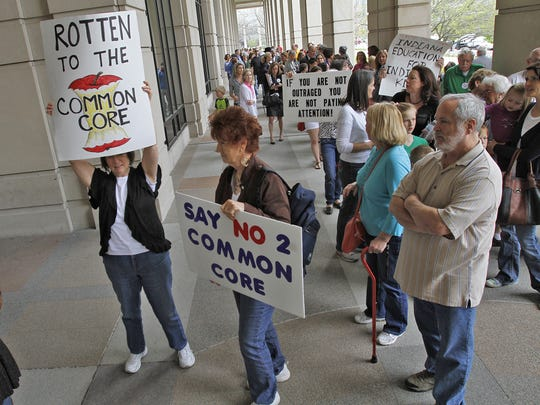 After the Hoosiers Against Common Core rally at the Statehouse on April 21, 2014, participants -- including Carol Scudder (from left), Brownsburg, and Linda Miller, North Salem -- walked to attend the Indiana Education Roundtable meeting at Government Center South, Indianapolis.