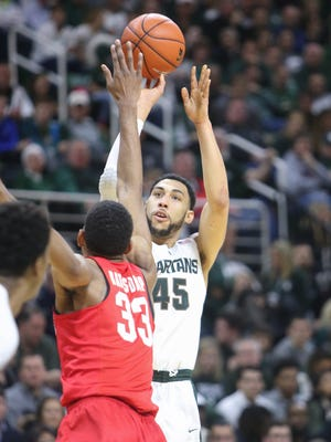 Michigan State Spartans Denzel Valentine scores against the Ohio State Buckeyes Keita Bates-Diop during first half action on Saturday, March 5,2016 at the Breslin Center in East Lansing MI.