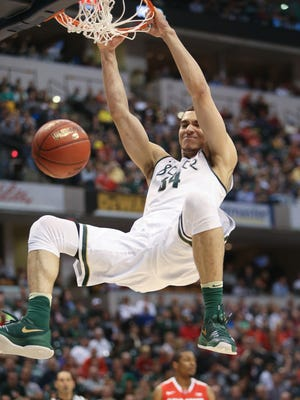 Michigan State's Gavin Schilling scores during the second half of MSU's 81-54 win Friday in the Big Ten tournament quarterfinal in Indianapolis.