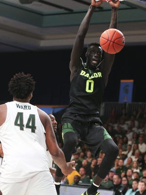 Baylor forward Jo Lual-Acuil Jr. dunks as Michigan State forward Nick Ward tries to defend in the second half of the Battle 4 Atlantis semifinal on Nov. 24, 2016.