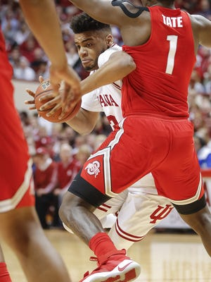 Indiana Hoosiers forward Juwan Morgan (13) makes a move to the basket against Ohio State Buckeyes forward Jae'Sean Tate (1) at Simon Skjodt Assembly Hall in Bloomington, Ind., on Friday, Feb. 23.
