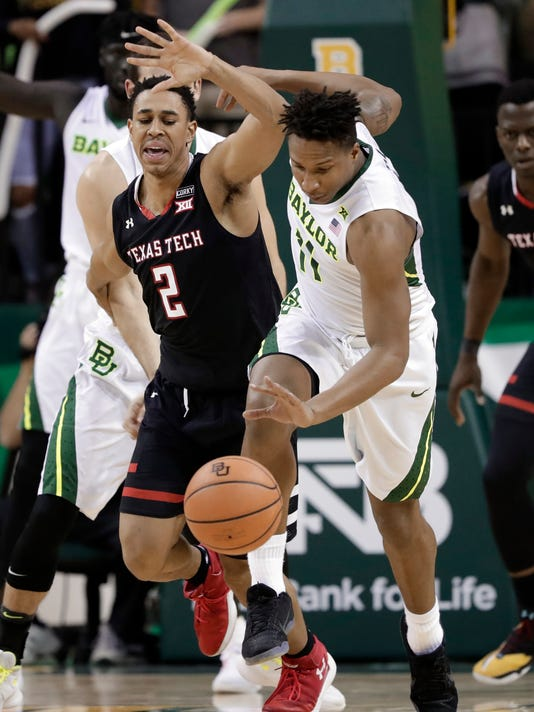 Texas Tech guard Zhaire Smith (2) loses control of the ball to Baylor's Mark Vital (11) in the second half of an NCAA college basketball game Saturday, Feb. 17, 2018, in Waco, Texas. (AP Photo/Tony Gutierrez)