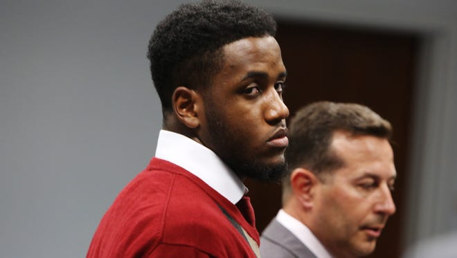 Former Florida State University football player De'andre Johnson and attorney Jose Baez listen to State Attorney Willie Meggs inside the Leon County Courthouse Monday during a hearing.
