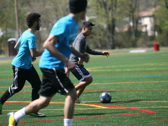 Soccer on the artificial turf field at Pennington Park