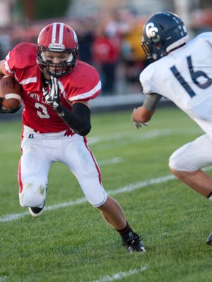 Football; Central Catholic at Twin Lakes. Bryce Bennington runs in 1st quarter.   By Jerry Schultheiss for Journal & Courier