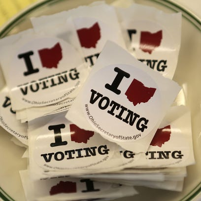 Voting stickers at the Episcopal Church of the Redeemer in Hyde Park on Tuesday, November 5, 2013. The Enquirer/Leigh Taylor