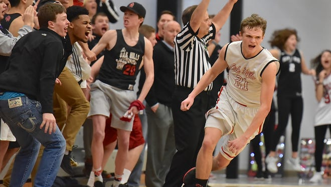 Oak Hills' Zach Moeller knocks down a three point shot late in the 4th quarter that forced overtime against Mason Friday, February 16th at Oak Hills High School