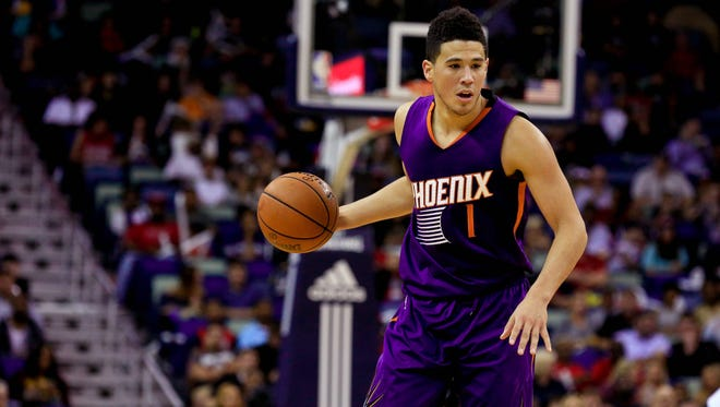 Nov 4, 2016; New Orleans, LA, USA; Suns guard Devin Booker (1) against the Pelicans during the second half of a game at the Smoothie King Center.
