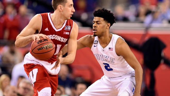 Apr 6, 2015; Indianapolis, IN, USA; Wisconsin Badgers guard Josh Gasser (21) controls the ball against Duke Blue Devils guard Quinn Cook (2) in the first half in the 2015 NCAA Men's Division I Championship game at Lucas Oil Stadium. Mandatory Credit: Bob Donnan-USA TODAY Sports