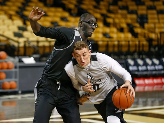 Tacko Fall guards teammate Rokas Uleydas during a UCF