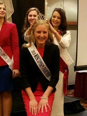Rebecca Starkenburg, 2017 Wisconsin Fairest of the Fairs, crowns her successor, Isabella Haen of Kewaunee County, during the annual Wisconsin Association of Fairs Convention.