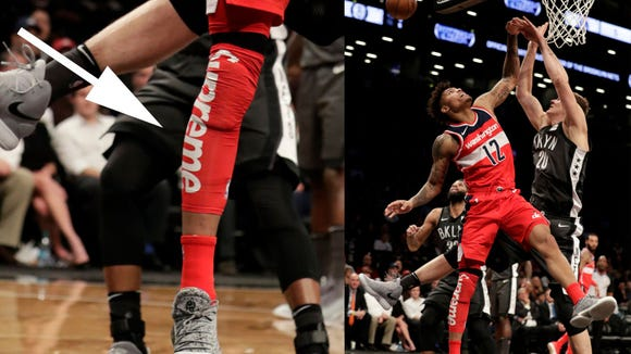 Wizards Kelly Oubre wearing Supreme leg sleeve in NBA game