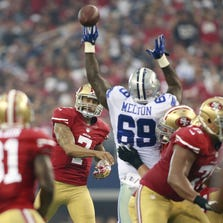 Sep 7, 2014; Arlington, TX, USA; San Francisco 49ers quarterback Colin Kaepernick (7) throws a pass to wide receiver Anquan Boldin (81) in the second quarter against the Dallas Cowboys at AT&T Stadium. Mandatory Credit: Tim Heitman-USA TODAY Sports