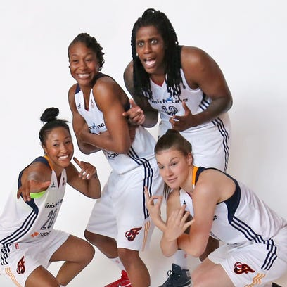 Indiana Fever teammates #20 Briann January, from left