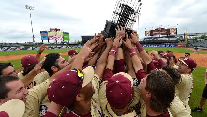 Players hold up the trophy following their victory in the 2017 ACC Baseball Tournament in Louisville, KY, Sunday, May. 28, 2017. (Photo By Timothy D. Easley, theACC.com)