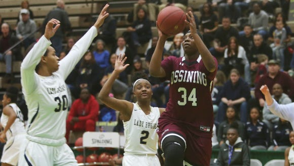 Ossining's Kailah Harris (34) puts up a shot against