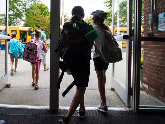 Students leave Orchard School in South Burlington at