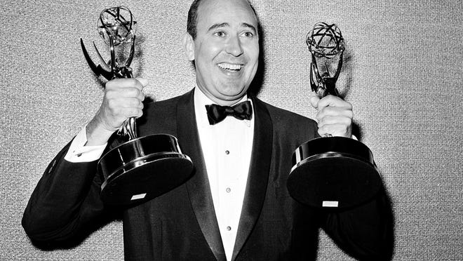 """Carl Reiner shows off two Emmy statuettes presented to him as best comedy writer for the """"Dick Van Dyke Show,"""" during the annual Emmy Awards presentation in Hollywood, Calif., on May 26, 1963."""