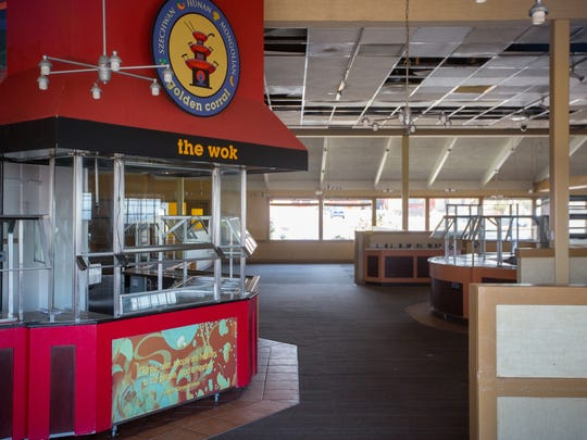 A closed Golden Corral restaurant sits empty off of
