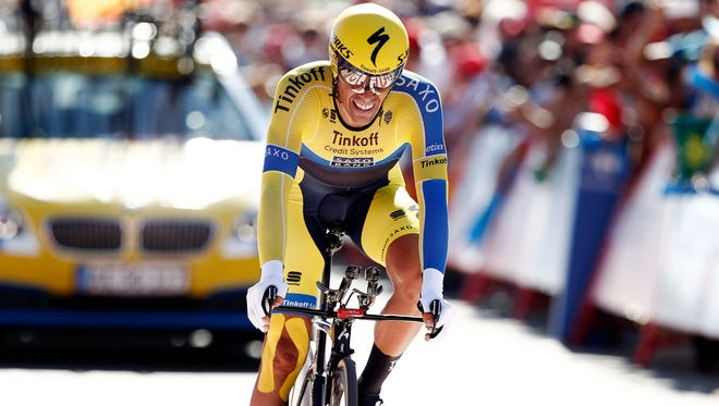 Spain's Alberto Contador competes at the time trial arrival the 36,7 kilometers (22-mile) time trial, Real Monasterio Santa Maria de Varuela-Borja, the 10th stage of the Spanish Vuelta cycling race,  in Borja, Spain, Tuesday.