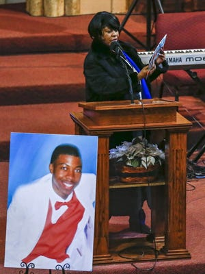 Janet Cooksey, the mother of Quintonio LeGrier, holds up and reads from a birthday card he sent her during his funeral service at New Mount Pilgrim Missionary Baptist Church in Chicago on Saturday. LeGrier, 19, was fatally shot by a Chicago police officer responding to a domestic disturbance call on Dec. 26, 2015. Police at the same time shot a neighbor, Bettie Jones, 55, three times killing her. Police later announced that the shooting of Jones was an accident.