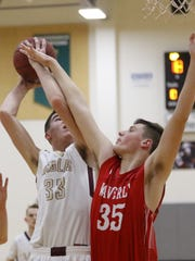 Aaron Austenfeld of Whitney Point has his shot contested