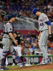 Jun 30, 2018; Miami, FL, USA; New York Mets starting pitcher Jacob deGrom (right) talks with Mets catcher Devin Mesoraco (left) in the sixth inning against the Miami Marlins at Marlins Park.