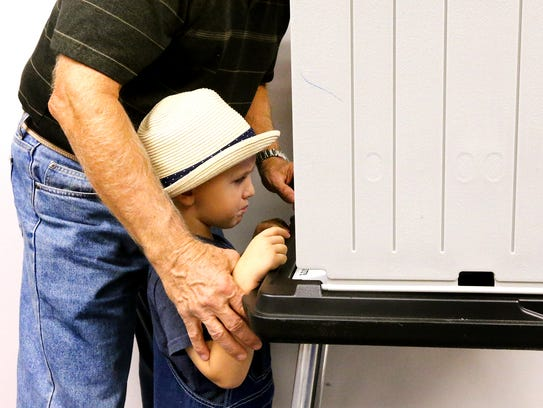 Mason Rowland, 3 goes to early vote with his grandfather