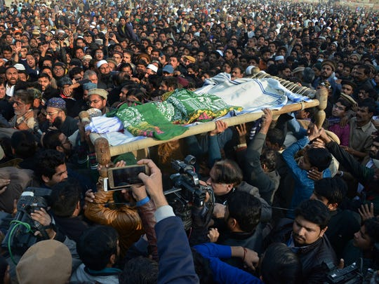 People attend a funeral of 7-year-old Zainab Ansari in Kasur, Pakistan, on Jan. 10, 2018. The brutal rape of Zainab, whose body was left in a garbage dump, has roiled conservative Pakistan and revealed a sexual predator who has raped and killed at least 11 girls in Zainab's hometown of Kasur.