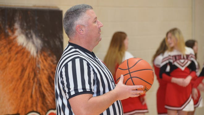 Battle Creek's Jim Grafton is the deputy chief of the city police department, but likes to spend his off hours as a varsity boys basketball referee.