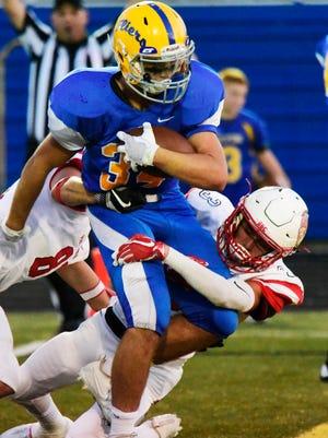 Braydi Clark tries to break free from two Port Clinton defenders. He scored two touchdowns.