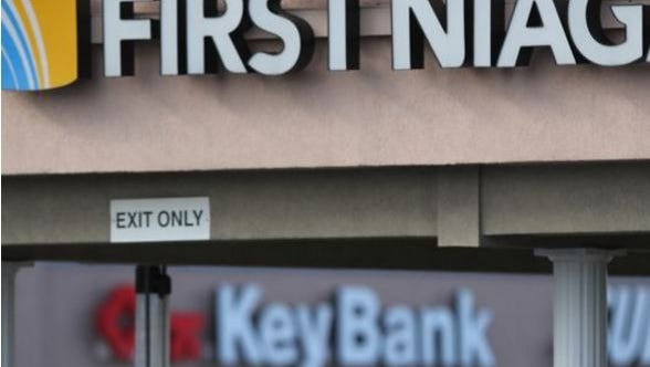 KeyCorp is buying First Niagara Bank with 10 branches possibly closing. Currently in the Culver Ridge Plaza in Irondequoit a KeyBank is four businesses down from a First Niagara Bank branch.