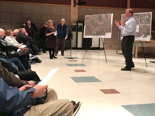 NJ DOT consultant Bernie Boerchers at an information session Tuesday, March 28 in the auditorium of Kinnelon High School fields questions from the crowd.
