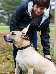 Butchie, with owner Kim Shaneybrook, poses for a photo at a party for his adoption at the Worcester County Humane Society on Nov. 11 in Berlin.