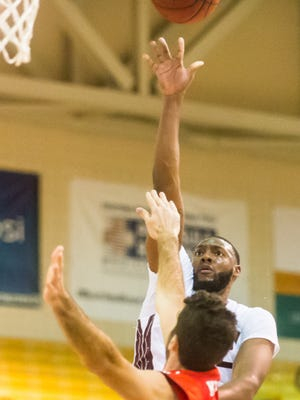 UMES forward Dominique Elliott (32) takes a shot against Fairfield at the Hytche Center in Princess Anne.