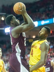 UMES forward Bakari Copeland (21) takes a shot against Maryland's Robert Carter Jr. (4) at the Xfinity Center in College Park on Saturday, Dec. 12, 2015.