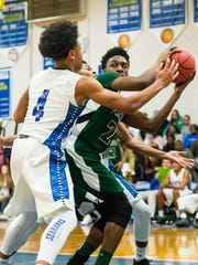 Parkside guard Gary Briddell (20) looks to pass while guarded by Stephen Decatur guard Darian McKenzie (4) on Thursday, January 14 in the Bird Cage at Stephen Decatur High School.