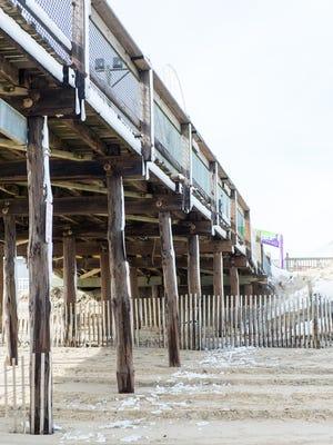 The Ocean City pier lies in disrepair Monday following weekend winter storms in the resort.
