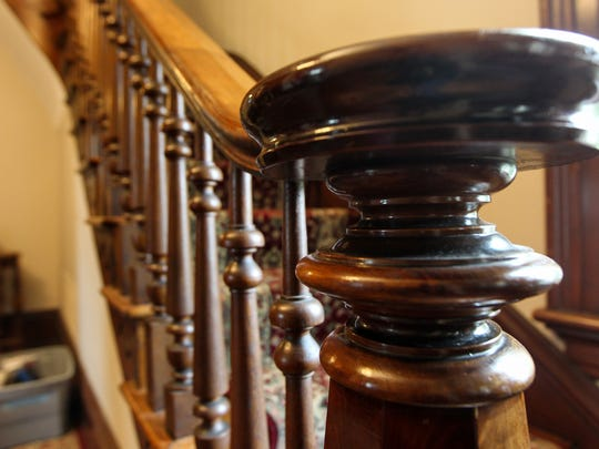 The original wooden bannister at the historic home