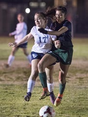 Redwood's Payton Basso, left, and El Diamante's Cassandra Romero battle in a West Yosemite League high school girls soccer game Friday, January 27, 2017.