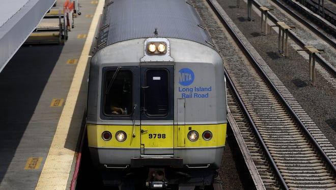 A Long Island Railroad train pulls into the Woodside stop in the Queens borough of New York, Tuesday, July 15, 2014. Union negotiators said Monday that weekend talks had collapsed amid a dispute over whether future Long Island Rail Road employees should be required to contribute to their health insurance and pensions. (AP Photo/Seth Wenig)
