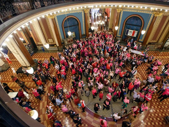 Planned Parenthood supporters rally in the Capitol after an overflowing Iowa Senate Committee hearing on a bill to defund Planned Parenthood on Tuesday, Jan. 24, 2017.