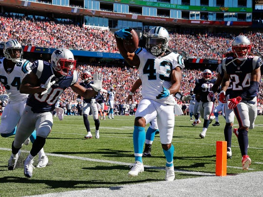 Carolina Panthers running back Fozzy Whittaker scores a touchdown past New England Patriots free safety Duron Harmon and cornerback Stephon Gilmore during an NFL football game at Gillette Stadium in Foxborough, Mass. Sunday, Oct. 1, 2017. (Winslow Townson/AP Images for Panini)