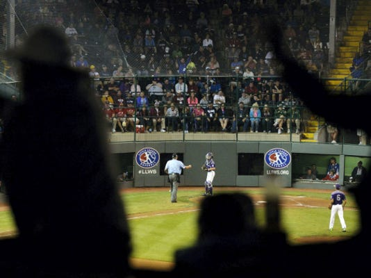 Spectators perform the wave during the fourth inning of Red Land's victory against Pearland, Texas, Wednesday, at the Little League World Series at Howard J. Lamade Stadium in South Williamsport.